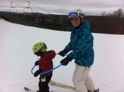 Teaching a child to ski using a hula hoop