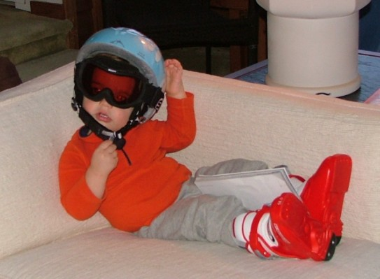 teaching a toddler to ski by starting indoors